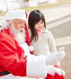 Girl And Santa Claus Taking Selfportrait Through Stock Images
