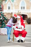 Girl And Santa Claus Using Digital Tablet Royalty Free Stock Photo