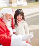 Girl With Santa Claus Using Smartphone Stock Photos