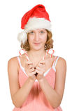 Girl in a santa clause cap with candy canes Royalty Free Stock Photography