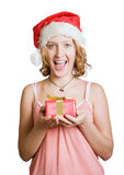 Girl in a santa clause cap with present Stock Photo