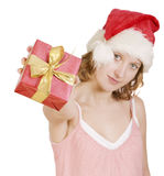Girl in a santa clause cap with present Royalty Free Stock Photos