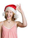 Girl in a santa clause cap with snowflake Royalty Free Stock Photography