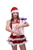 Girl in santa clause dress and some gifts. Closeup portrait of beautiful girl with green eyes weared in santa clause dress and some gifts Royalty Free Stock Photos