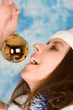 girl in santa cloth with holiday ball Royalty Free Stock Photography