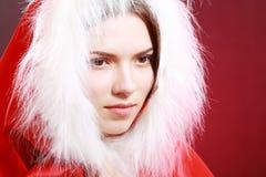 Girl in santa cloth Stock Photos