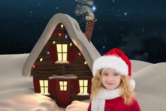 Girl in santa costume against digitally generated background Stock Image