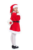 Girl in santa costume preparing a surprise Royalty Free Stock Photography