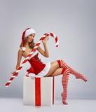 Girl in Santa dress stock images