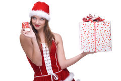 Girl in santa dress and some gifts. Closeup portrait of beautiful girl with green eyes weared in santa clause dress and some gifts Stock Images