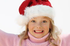 Girl in Santa hat. A cute little girl sporting a Santa hat Royalty Free Stock Image