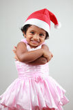 Girl with Santa hat Stock Photography