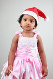 Girl with Santa hat Stock Photo
