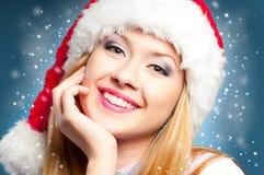 Girl in Santa hat. Happy face smiling woman in Santa Claus hat Stock Photos