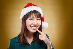 Girl with santa hat Royalty Free Stock Image