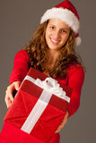 Girl in Santa Hat  Stock Images