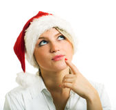Girl in Santa hat. Royalty Free Stock Image