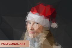 Girl in Santa hat. Abstract polygonal face. Stock Photo