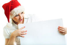 Girl in Santa hat with banner. Stock Photography