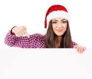 Girl in Santa hat Stock Images