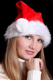 Girl in santa hat  on black Royalty Free Stock Photo