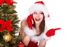 Girl in santa hat call by mobile phone . stock image