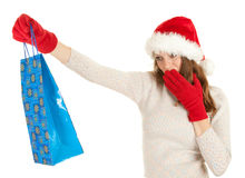 Girl in Santa hat carrying shopping bag Royalty Free Stock Images