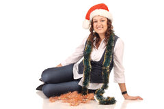 Girl in a santa hat with christmas decoration Royalty Free Stock Photos
