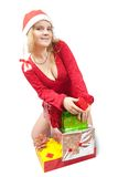 Girl in a santa hat with Christmas gifts Stock Photography