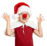 Girl in santa hat with clown nose on white isolated Stock Photography