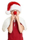 Girl in santa hat with clown nose on white isolated Stock Images