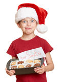 Girl in santa hat with cookies lick oneself - winter holiday christmas concept Stock Images