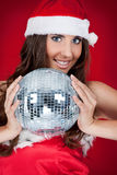 Girl with santa hat and disco ball Royalty Free Stock Photo