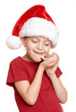Girl in santa hat eat cookies and lick oneself - winter holiday christmas concept. Girl in santa hat eat cookies and lick oneself - a winter holiday christmas Stock Images