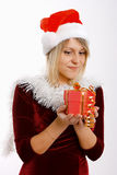 Girl in santa hat with a gift Royalty Free Stock Photo