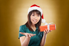 Girl with santa hat and gift Stock Photography