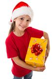 Girl in Santa hat with gift box Stock Photo