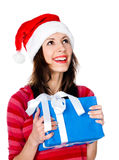 Girl in Santa hat with gifts Stock Photography