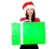 Girl in Santa hat with gifts Royalty Free Stock Photo