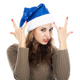 Girl in santa hat goats showing rock-n-roll sign. Isolated on white background Stock Image