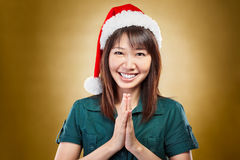 Girl with santa hat greeting Stock Photography