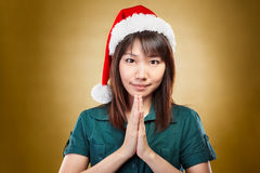 Girl with santa hat greeting Stock Image