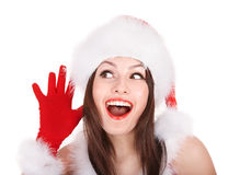 Girl in santa hat with hand near ear listen. Royalty Free Stock Photos