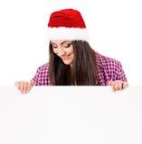 Girl in Santa hat Royalty Free Stock Image