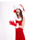 Girl in santa hat holding  banner. Stock Photo