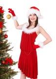 Girl in santa hat holding christmas ball. Stock Images
