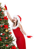 Girl in santa hat holding christmas ball. Royalty Free Stock Images