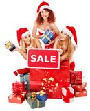 Girl in Santa hat holding Christmas gift box. Royalty Free Stock Photography