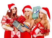 Girl in Santa hat holding Christmas gift box. Royalty Free Stock Images