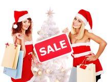Girl in Santa hat holding Christmas gift box. Stock Images